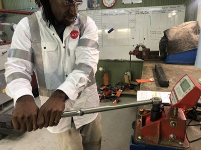 Joshua calibrating a torque wrench