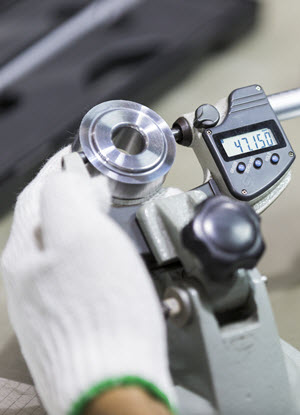 An ABM technician calibrating automotive equipment